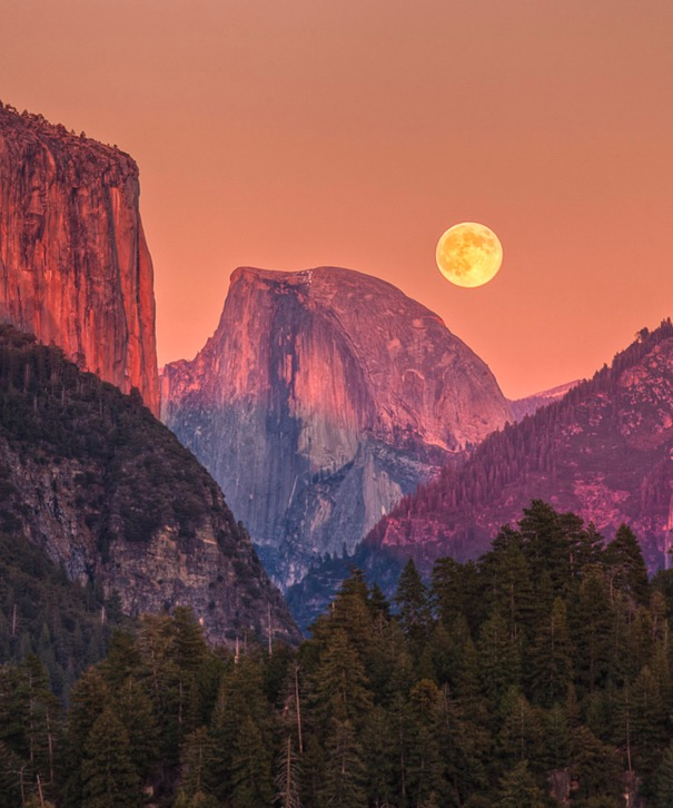 The moon hangs low over Yosemite, CA
