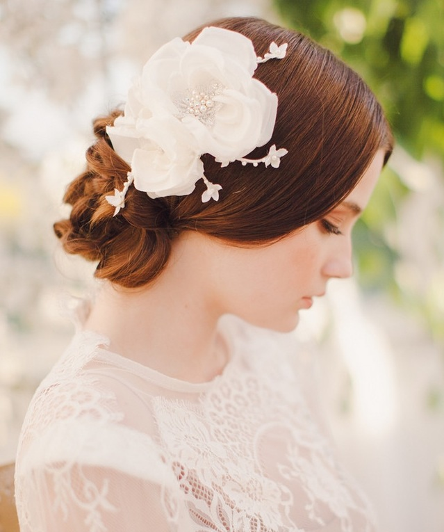 Ethereal low bun bridal upstyle with floral headpiece