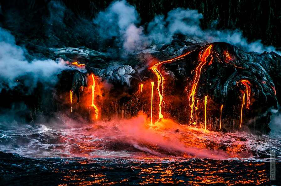 Lava from the Kilauea volcano flowing into the ocean