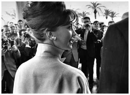 Actress natalie wood with actor warren beatty only back of his shoulder showing surrounded