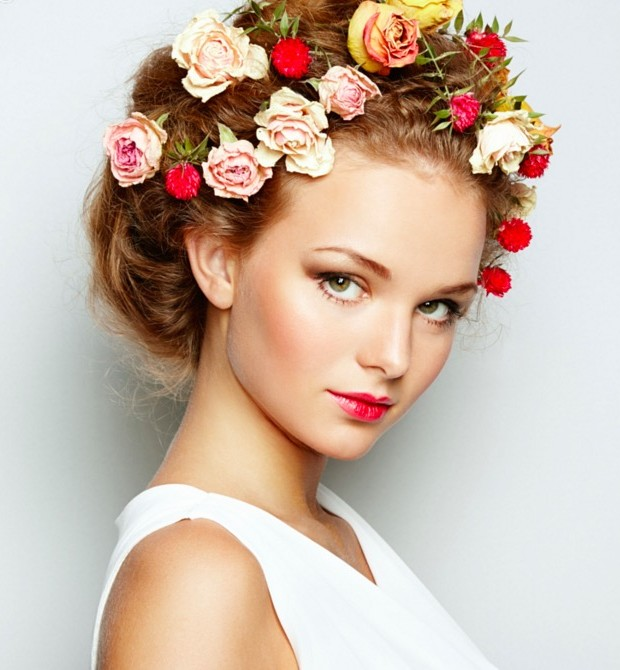 Beautiful woman with flowers perfect face