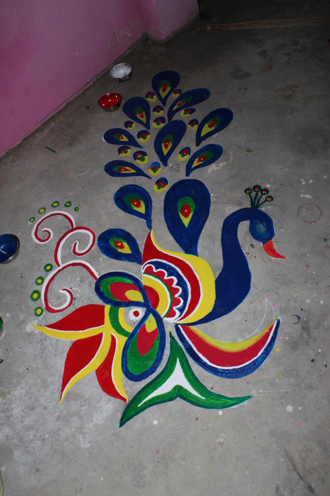 Peacock style colouring Rangoli
